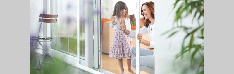 Mother and daughter in front of a sliding door with an insect screen installed.