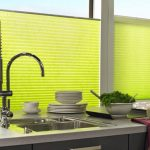 Pleated blinds used in a kitchen setting.