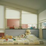 Pleated blinds used in windows for a children's room.